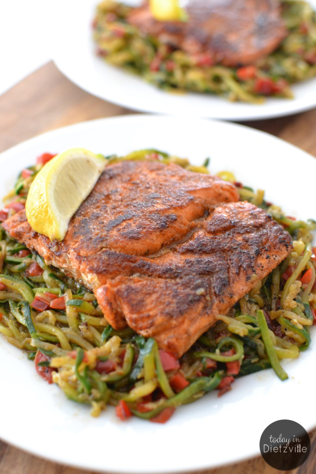 Blackened Salmon Over Cajun Zoodles {in 1 skillet!} |Me + spicy, Cajun food = true love. Here's a Paleo, Whole30, THM-friendly version of a classic Cajun favorite -- Blackened Salmon Over Cajun Zoodles in just 1 skillet! | TodayInDietzville.com